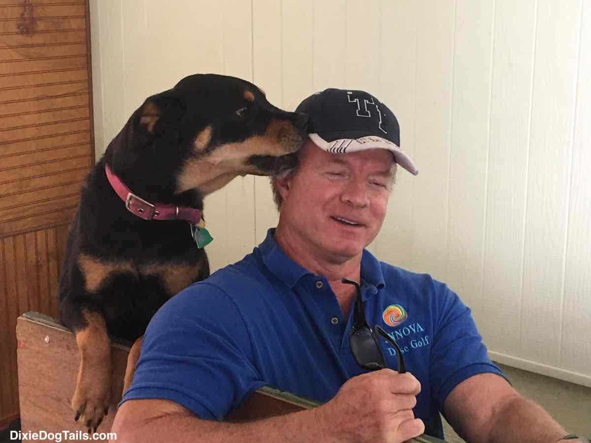 Dog smelling mans head