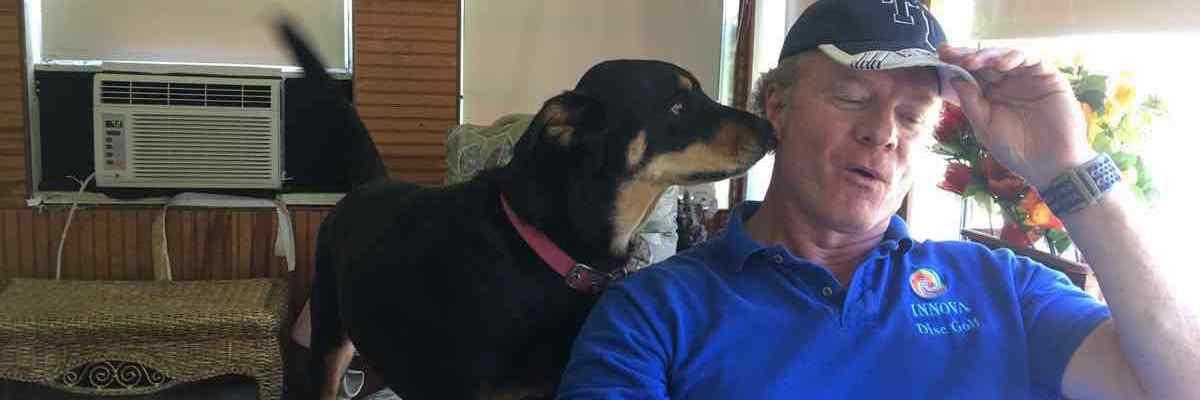 Dog smelling mans ear